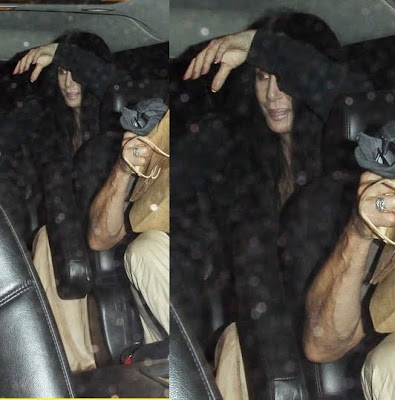 Cher attempts to hide her face from the paparazzi