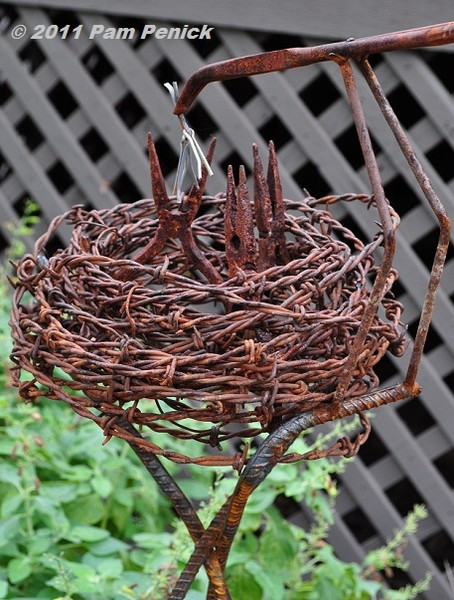Dishfunctional designs beautiful upcycled barbed wire for Wire yard art