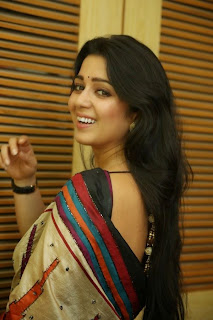 Actress Charmi Kaur Pictures in Saree at Jyothi Lakshmi First Look Launch  5