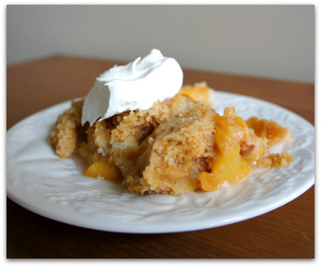 Easy peach cobbler recipe made in the slow cooker. Don't forget to top with whipped cream!