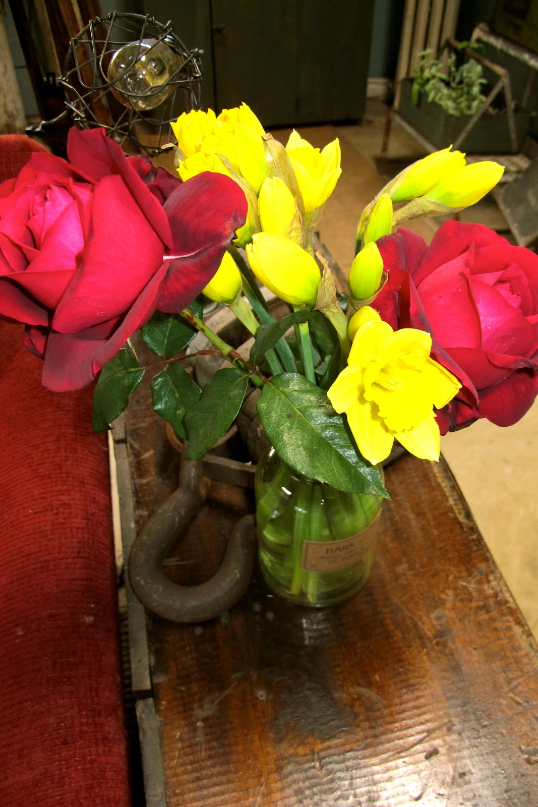 Just practicing random acts of kindness the love of a garden i mixed in some of the red mary lou heard red roses with the daffodils that i so love they are super cheap and such beautiful flowers if you look at them izmirmasajfo