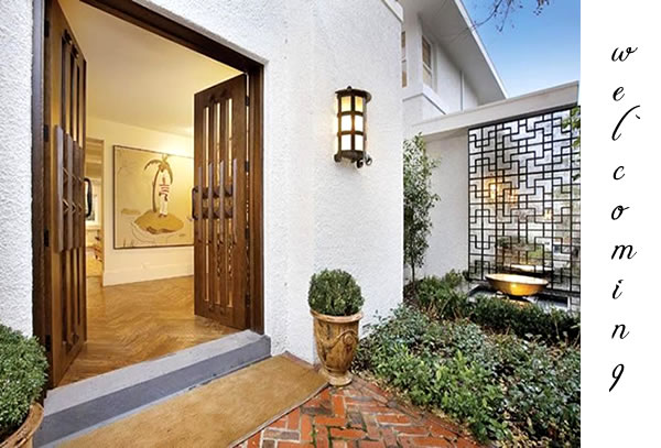 Fabulous front entrance patterned timber doors with a for Fabulous front doors