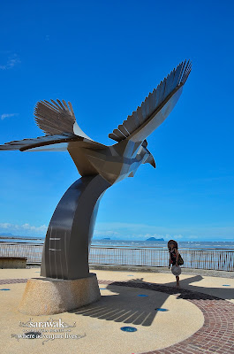Giant hornbill statue against the azure sky; Damai Central