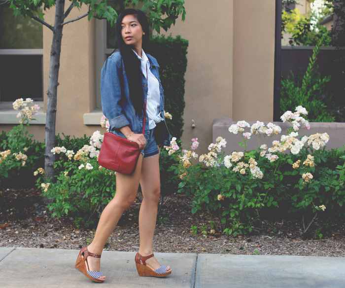 Stephanie Liu wearing Levi's jacket, Rich & Skinny Bondi shorts, Tignanello crossbody, Wildfox cuff, and Dr. Scholl's Shoes