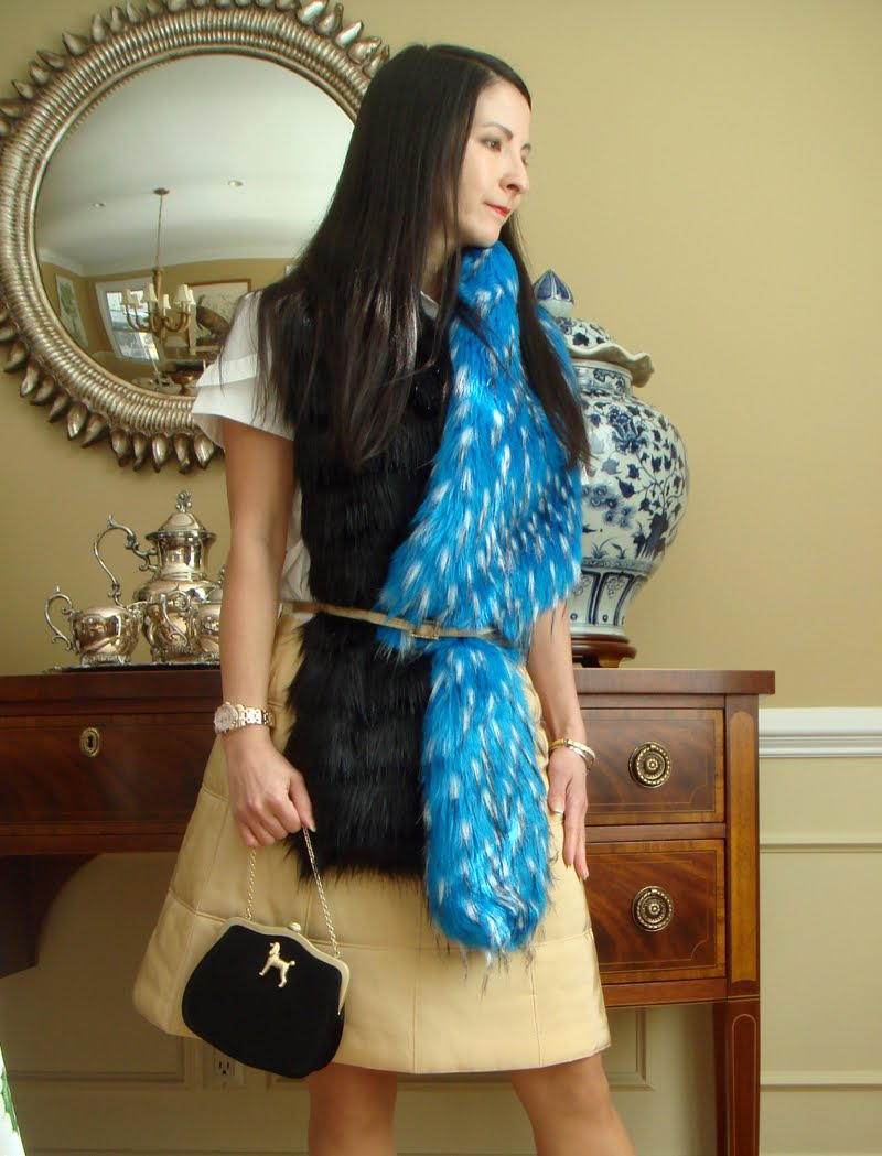 Fur scarf belted close up with black mini bag with dog.