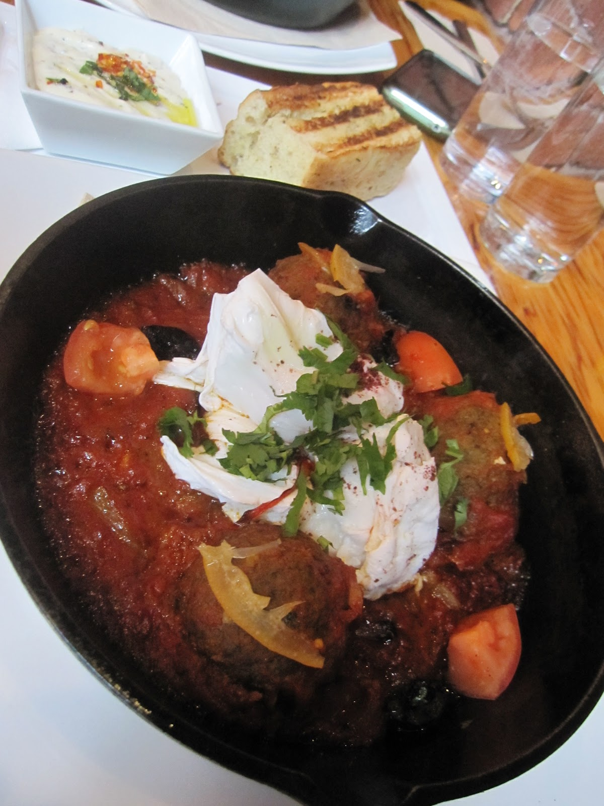 ... lamb and beef meatballs, cilantro, houmus, raita. Grilled foccacia. ($