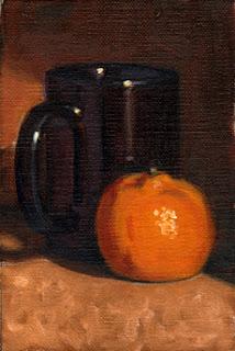 Oil painting of a dark blue coffee mug next to a mandarine.