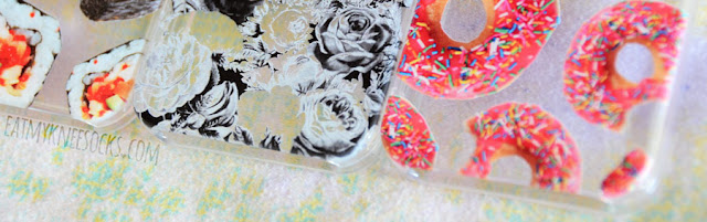 Close-up on the detailed printed sushi rolls, floral print, and donut-print phone cases from Clash Cases on Etsy.