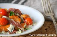 Süßkartoffel-Gnocchi mit Gorgonzolasauce, Rucola und Kirschtomaten