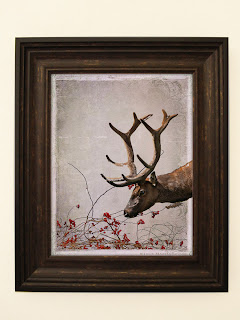 a peaceful elk leaning over some festive red berry branches in an antique vintage style