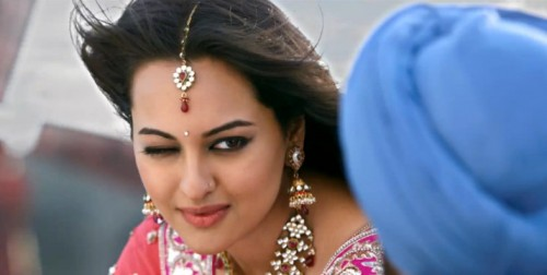 Sonakshi Sinha wink photo with heavy Jhumkas