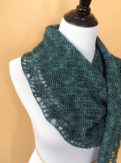 http://www.ravelry.com/patterns/library/candeo-shawl-boomerang-style
