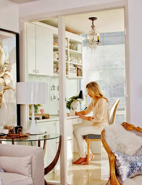 traditional style white home office with crystal chandelier