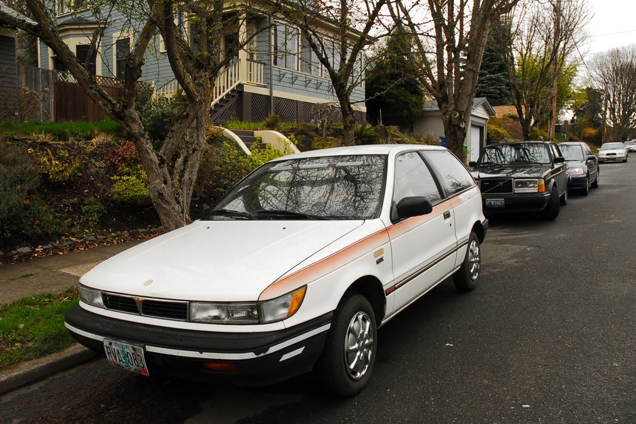 OLD PARKED CARS.: 1991 Mitsubishi Mirage.