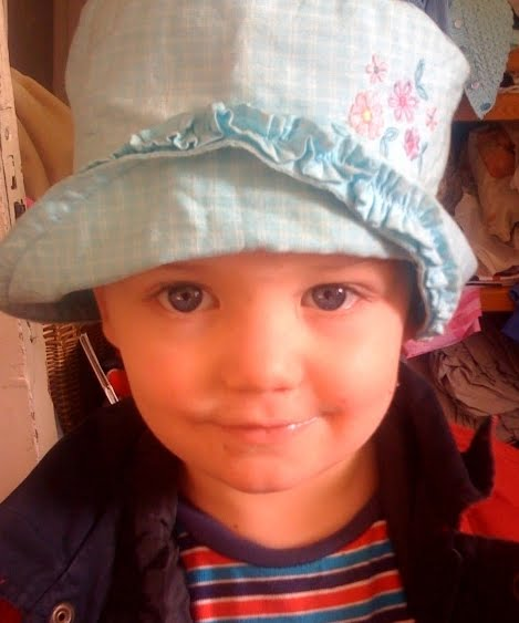 boy in girl hat