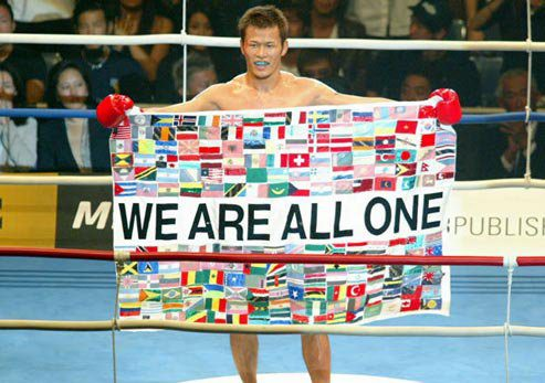 Genko Sudo with a flag - We Are All One