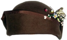 brown felt cloche with flower spray