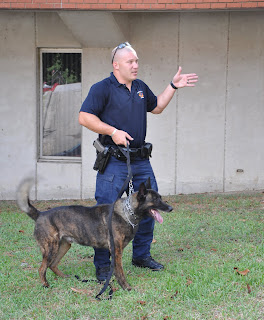 Huntsville Officer Blane Rodgers and Quintus