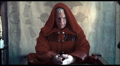 Ron Perlman contemplates how to spend his pay cheque in The Mutant Chronicles, Grosvenor Park Productions 2008