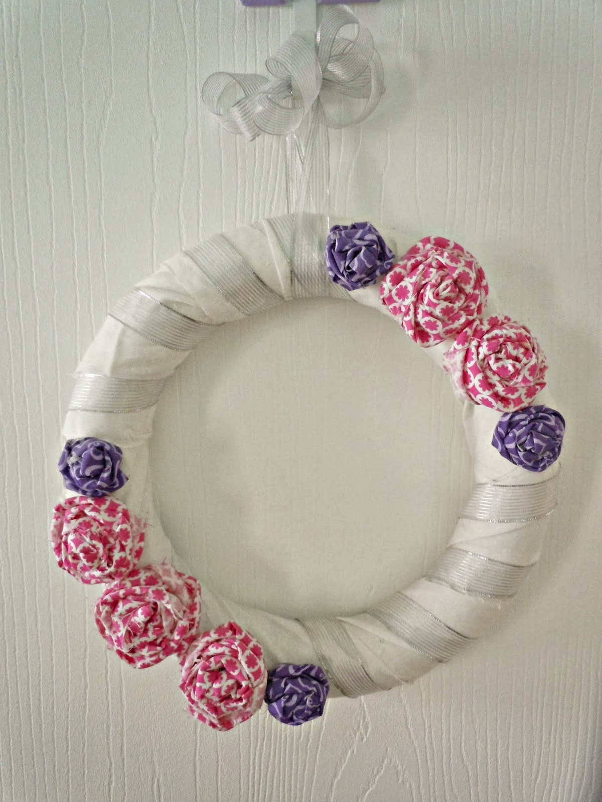 http://www.lifealittlebrighter.com/2013/02/fabric-rose-wreath.html