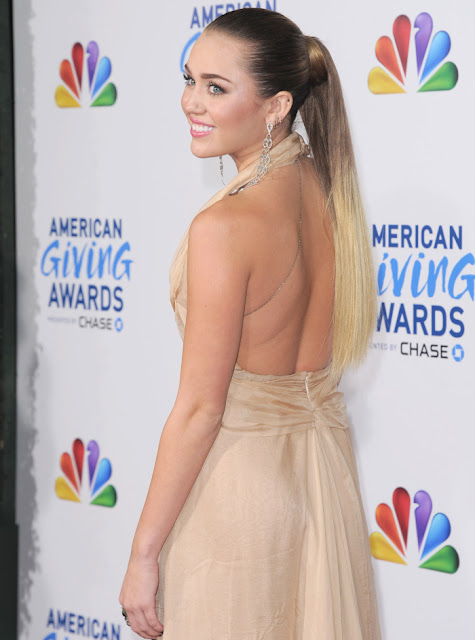 Miley Cyrus in a wrinkled Jenny Packham gown
