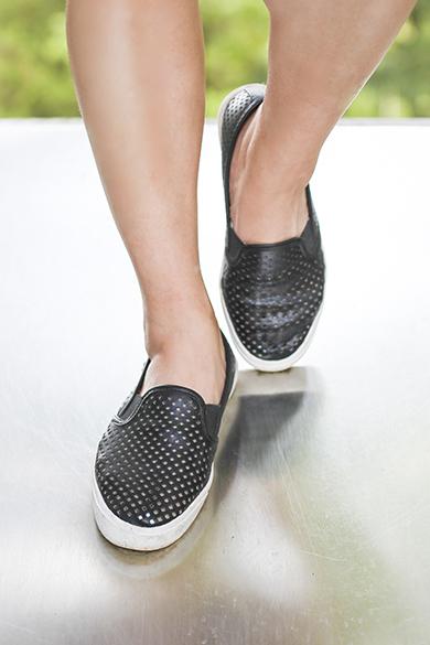 Black sneakers on a slide