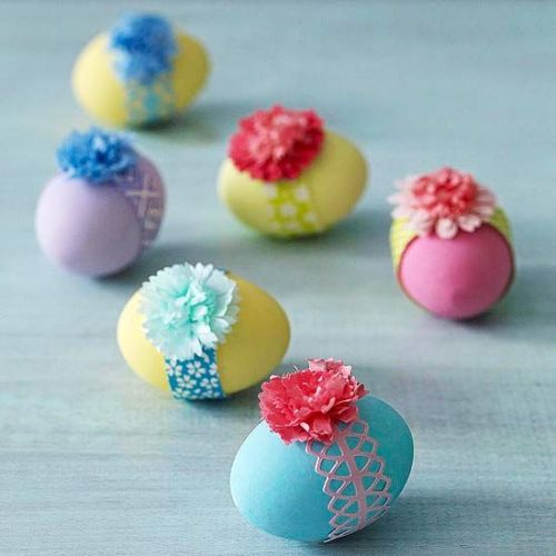 pretty Easter eggs with colorful ribbons