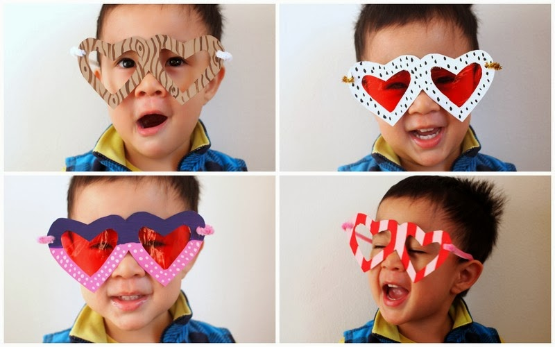 child wearing heart shaped glasses