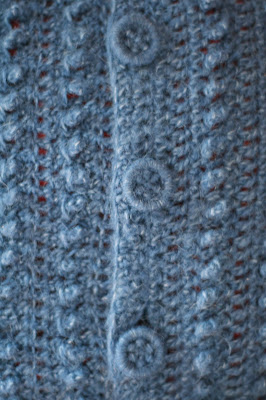 Dorset buttons on knitted sweater