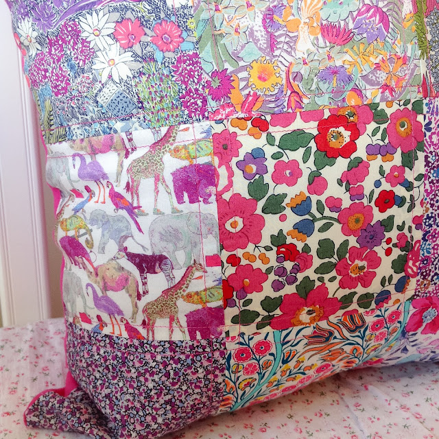 Closeup Patchwork Cushion Detail showing Liberty Betsy and Queue For The Zoo Print