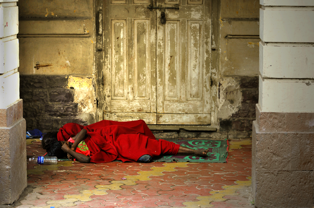 People sleeping on the pavement in the southern part of Bombay.