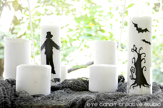 vinyl on candles, spooky silhouettes, black cloth, halloween decor