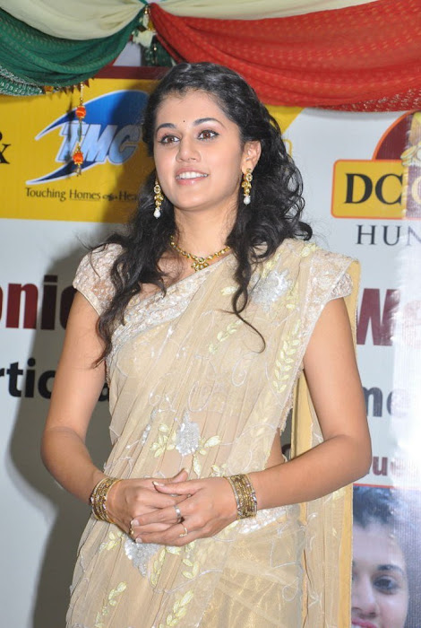 tapsee in saree at tmc electronics actress pics