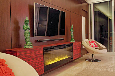 modern electronic devices are combined with religious buddha statues that creates tranquil room scheme