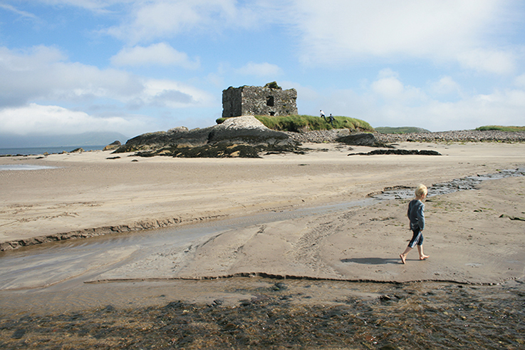 castle on an irish beach