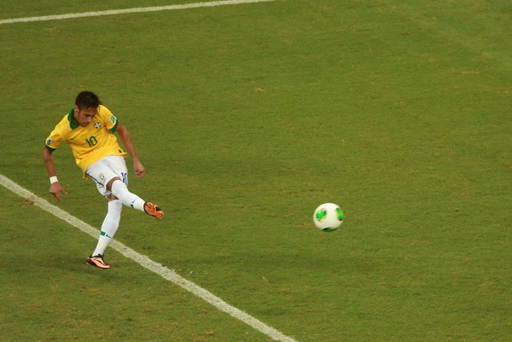 Brazil forward Neymar scores his side's second goal against Italy from a free-kick