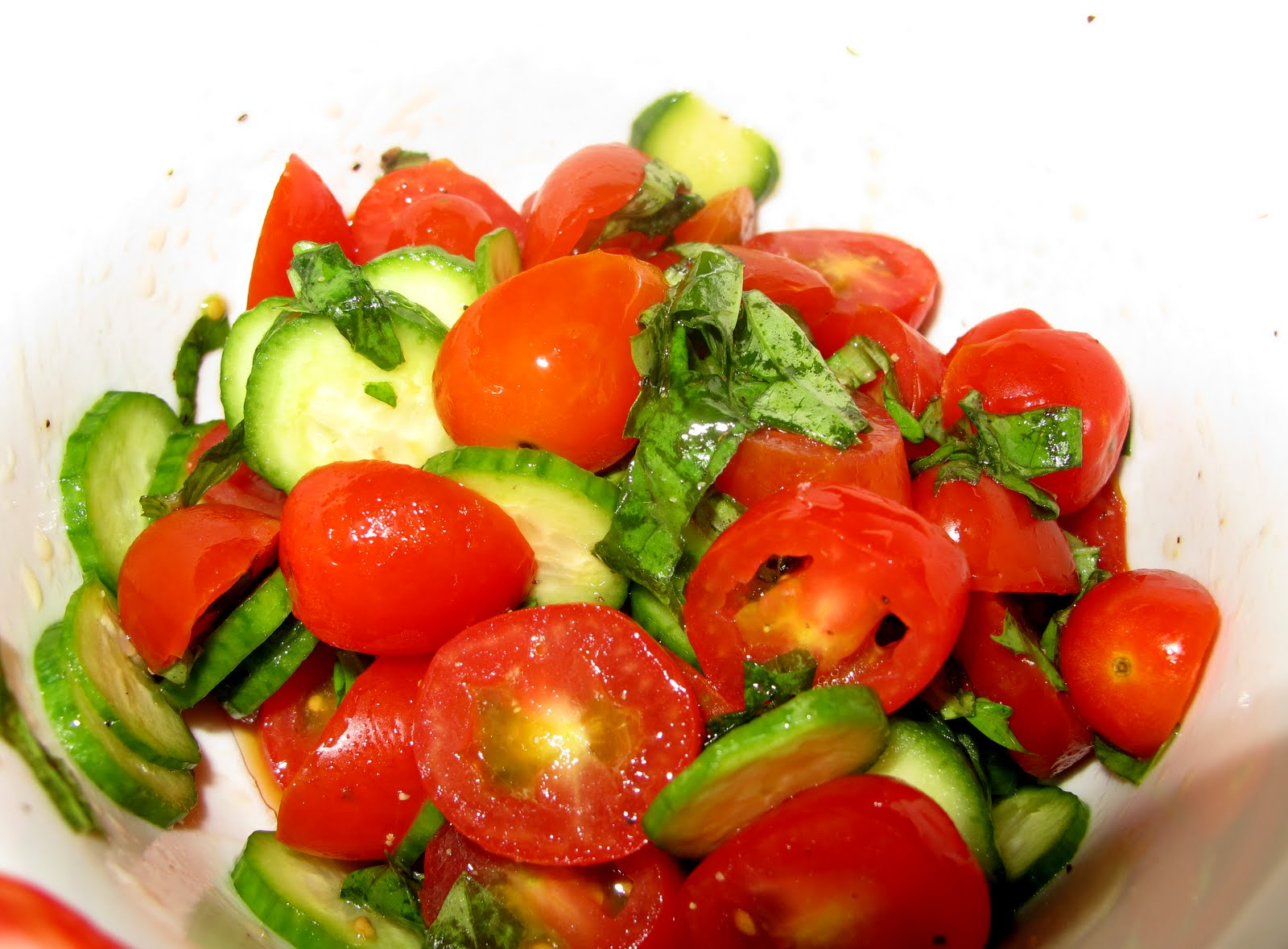 fresh grape tomatoes, baby cucumber and basil salad drizzled with ...