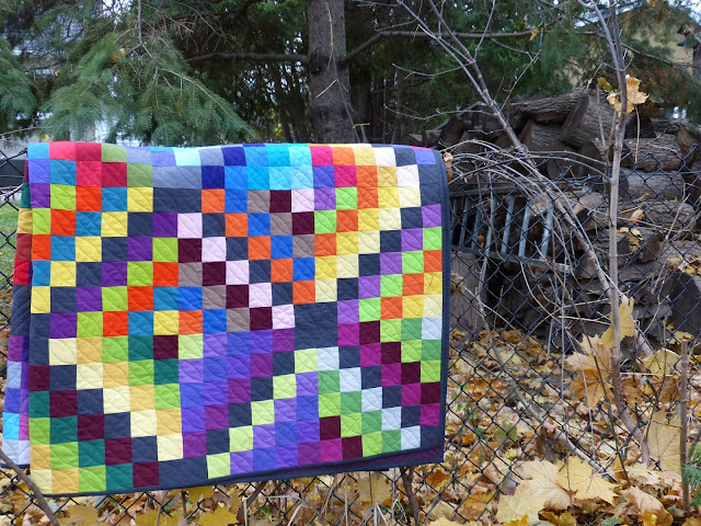 Carsick quilt re-folded and hanging on fence