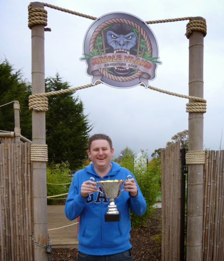 Surrey Invitational Tournament Minigolf Champion Matt 'The Don' Dodd with the S.I.T. trophy at Jungle Island Adventure Golf in Epsom