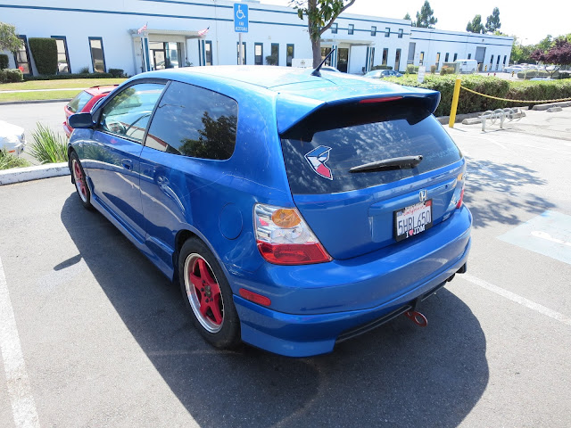 Civic with peeling paint and key scratches before paint at Almost Everything Auto Body
