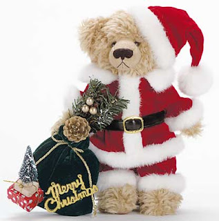 Christmas teddy bear decorated with Santa Claus dress and hat with gifts picture