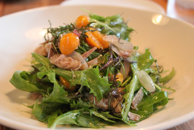 Dandelion salad with duck confit and gooseberries at West Bridge, Cambridge, Mass.