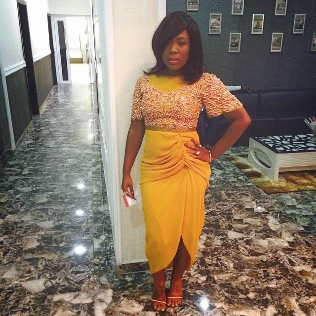 Moet Abebe Wearing a  Beautiful Yellow Virgos Lounge Dress