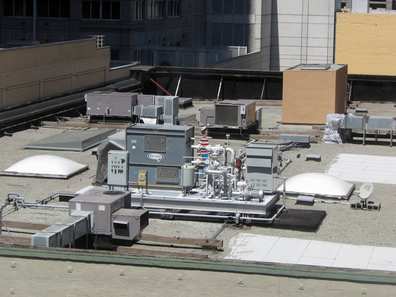 Air conditioning pipes and ducts on rooftop in San Francisco