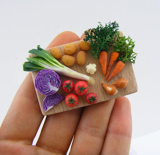 Polymer miniature vegetables on cutting board by Shay Aaron