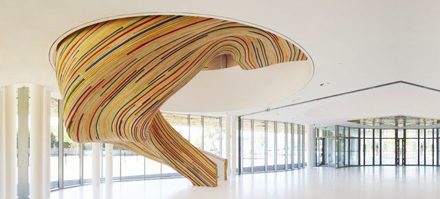 Colorful Spiral Stairs With Slides Design.