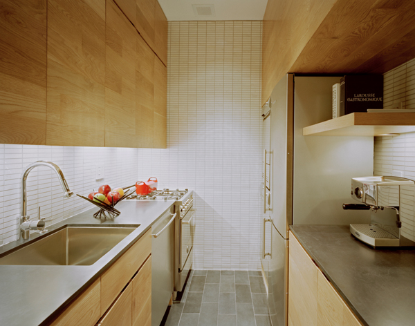 Photo of kitchen interiors showing sink, fridge and small working space