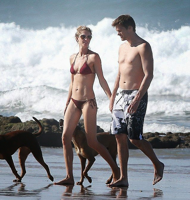 Gisele Bundchen looks sweet in a Maroon Bikini while vacationing in Costa Rica