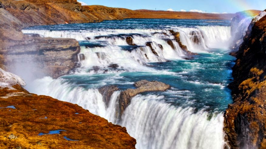 """Gullfoss, Icelandic for """"Golden Falls,"""" is a top tourist destination in Iceland. The falls that seem to drop directly into the earth have become so iconic that they have appeared on the cover of an album, in a novella and in a music video."""