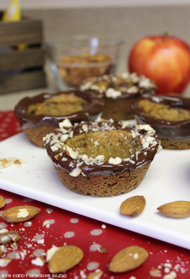 dip cookie cups in chocolate, sliced almonds, nestle toll house morsels